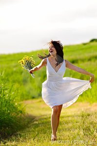 adorable-happy-summer-woman-skipping-18123505