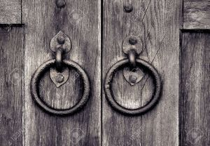 12012637-ancient-wooden-gate-with-two-door-knocker-rings-Stock-Photo-iron